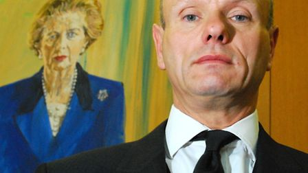 Mike Freer beside the portait of Margaret Thatcher in Portcullis House, Westminster. Picture: Polly