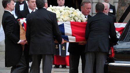 Pallbearers from Leverton & Sons carry Baroness Thatcher's coffin out of the hearse before taking it