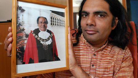 Ranjan Bhattacharya with a photo of his father Raman when he was Mayor of Camden circa 1993. Picture