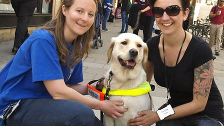 Guide dog trainers Laura Skinner (left) and Zoe Aird with dog Nan. Picture: Tony Gay