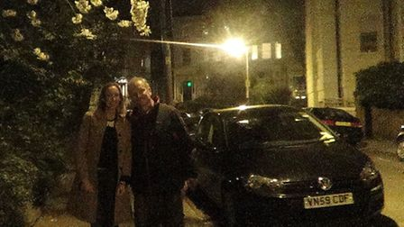 Cllr Claire-Louise Leyland and Cllr Jonny Bucknell in front of a brighter street lamp after their in