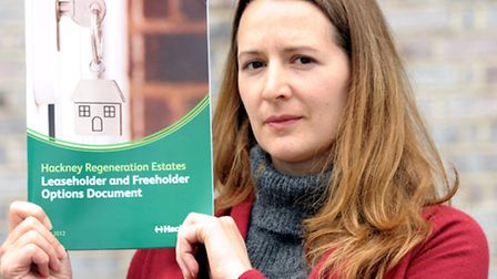 Emily Mackey with a Hackney Regenation Estates leaseholder and freeholder document