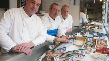 Brothers Andy (left) and Emi Theodorou, co-owners of Hampstead Seafoods, with staff member Dave Whee