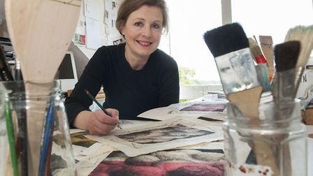Artist Marianne Nix in her studio with different versions of the print selected for the Royal Academ