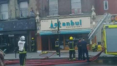 Firefighters tackle a fire that broke out at Istanbul Restaurant on Stoke Newington Road this mornin