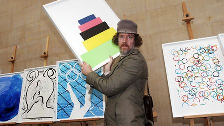 Artist Martin Creed with his poster, Work No. 1273, that has been unveiled as one of the official po
