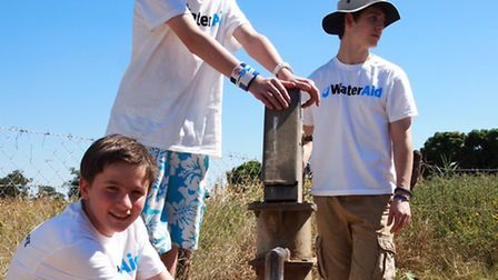 Wateraid - Nick, front and Lea, at a clean water pump in Zambia with George Rosenfeld