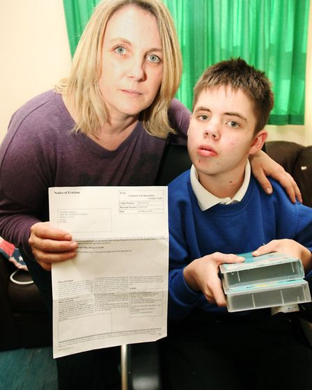 Mother-of-three Debbie Hawkins and son George with the eviction letter which forced them to move fro