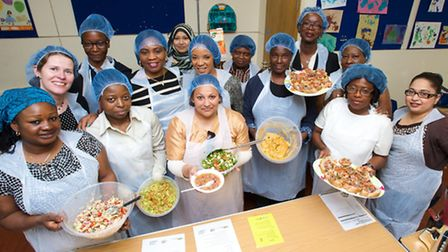 Residents demonstrate their cooking skills after completing a five-week food safety course