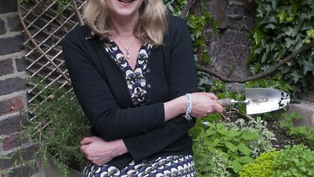 Alison Worster in the garden at her Kentish Town home. Picture: Nigel Sutton.