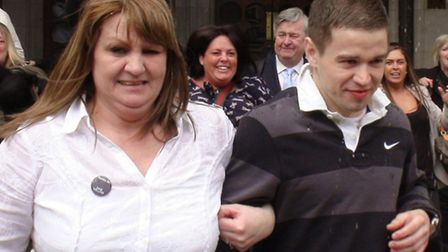 Sam Hallam, 24 leaves the Court of Appeal in London, with his mother Wendy Cohen, after he was freed
