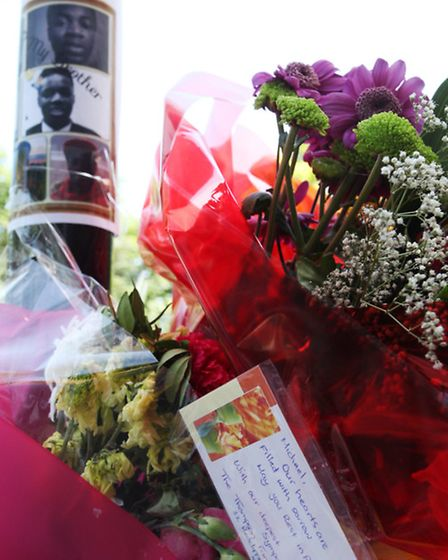 Floral tributes lie at the scene in Rogate House, Nightingale Estate, where teenager Michael Adu-Boa