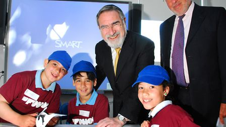 Chief Rabbi, Lord Jonathan Sachs, with sponsor David Lewis and children from Mathilda Marks School w