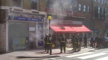 Firefighters at the scene after a smoke bomb security system set off a false alarm at Boots in Hamps