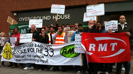 Members of the RMT union gather outside London Overground's head office in Swiss Cottage in a disput