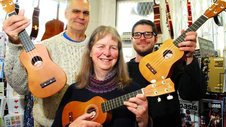 Co-owners Dot Fraser (front), Noel Fraser (left) and Max Perryment (shop worker and ukulele expert)