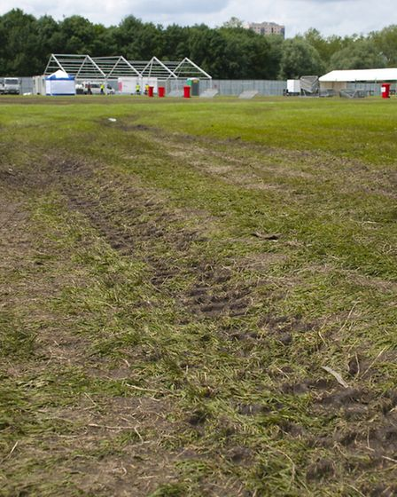 Tyre ruts in the ground after the concert