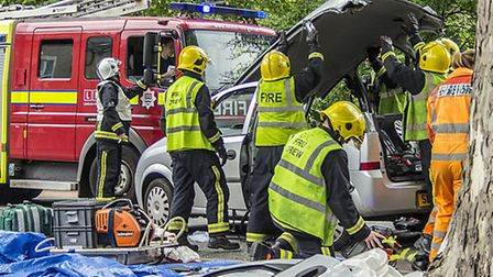 Fire fighters remove the roof of the car after the accident in Lea Bridge Road. Photo Kriss Lee www.