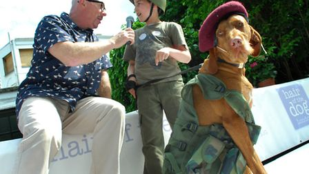 Third prize winner in best dressed Biba with owner Teddy, nine, who had dressed to mark Armed Forces