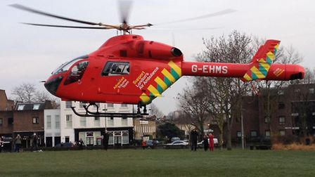 London's air ambulance attends the scene of the shooting in Queen's Crescent, Kentish Town, earlier