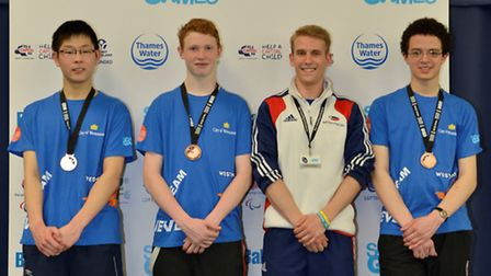 Members of the Westminster fencing team collect their London Youth Games bronze medals from GB fence