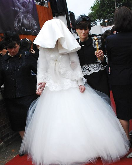 Bride Shprintzy Lipschitz, from the Bobov community, makes her way towards the Chuppah outside the