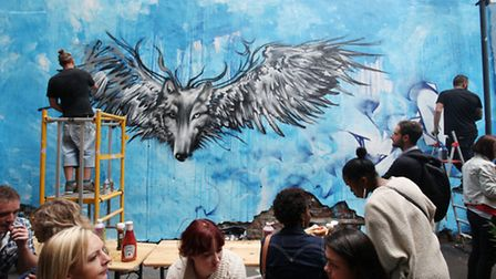Jimvision,left, and Andreariot delight the public with some live graffiti art at the Rivington Stree