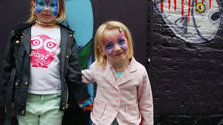 Sisters India Rose,left, and Laila Howarth show off their butterfly-themed face painting at the Rivi