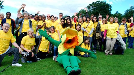 Daffy, the Marie Curie daffodil mascot, with walkers before setting off on the Hampstead Hug sponsor
