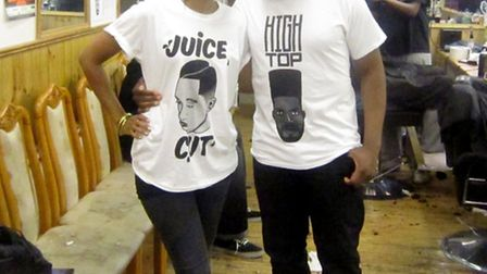 Lakwena and Mark MacIver pose in the t-shirts they collaborated on