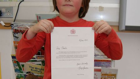 Charlie Hicks holding his letter from the Queen.