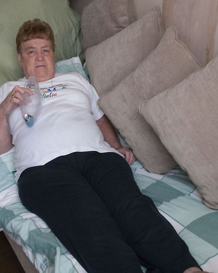 Ms Morahan has slept on the sofa for nearly a year because the mould in her bedroom makes her condit