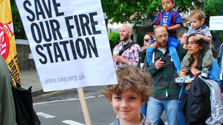 Alexander, seven, turned out to support Belsize fire station at a march earlier this year. Picture: