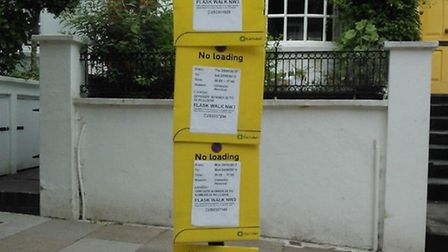 Parking suspension notices in Flask Walk. Picture: Alistair Cane/Twitter.