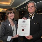 Silversmith Sophie Stamp being presented with her QEST award by Nick Farrow, chairman of the Royal W