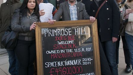 Local shopkeepers and residents protest outside Space NK shop in Primrose Hill, with Phil Cowan (cen