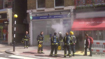 Smoke billows from the front of the pharmacy after the security device was set off