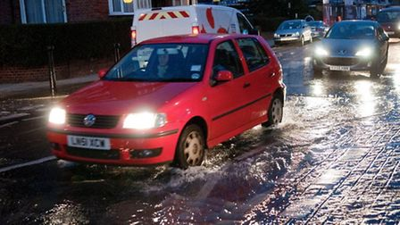 A burst water main in West Hampstead earlier this year. Picture: Nigel Sutton