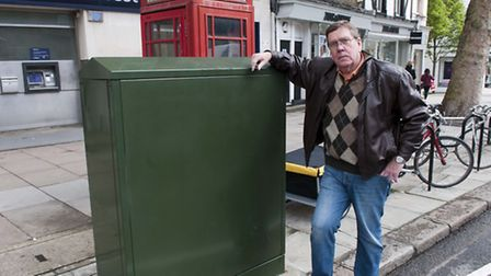 Cllr Chris Knight with much-despised BT broadband box that no longer needs planning permission