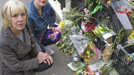Campaigners Sue Hessel (left) and Sarah Cope look at floral tributes to Jonathan Culverwell-Landsber
