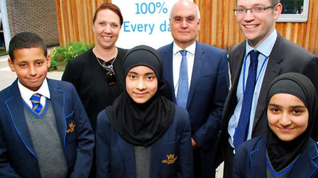 Sir Michael Wilshaw, centre, who made a special visit to King Solomon Academy, pictured with head of