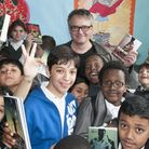 Writer Charlie Higson with pupils in the new library at Rhyl School. Picture: Nigel Sutton.