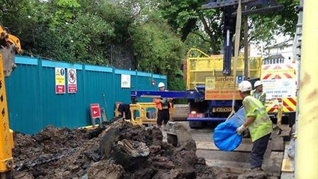 A crew from Thames Water get repairs underway on Sunday. Picture: Andrew Sampson