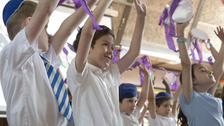 Children at the Simon Marks Jewish Primary School performing at its 40th anniversary.