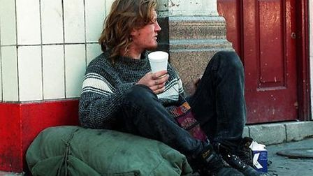 A homeless man sitting beside a doorway in Camden. Picture: PA/David Cheskin