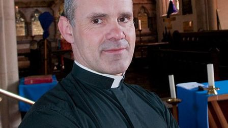 Father Andrew Cain is spearheading the plan to move a post office into St James Church. Picture: Ni