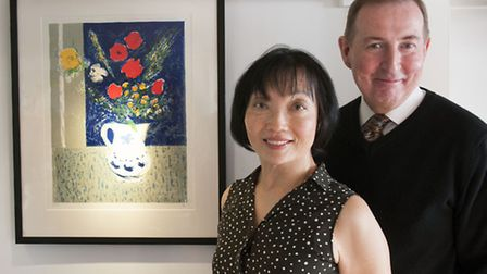 Gerald Moran and Cllr Linda Chung in front of one of the prints. Picture: Nigel Sutton