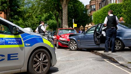 A BMW crashed into a parked car during a police chase in Lyndhurst Gardens, Hampstead. Picture: iWit