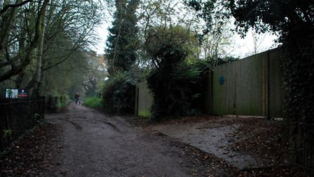 The Water House, seen on the right, is opposite the entrance to the Kenwood Ladies' Bathing Pond. Pi