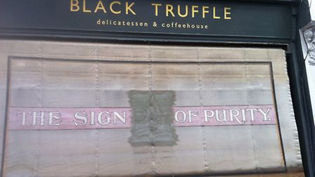The owner of Black Truffle deli uncovered The Sign of Purity vintage awning when renovating his shop